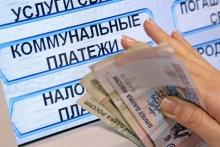 В платежки за ЖКХ вернулась комиссия: как платить без процентов